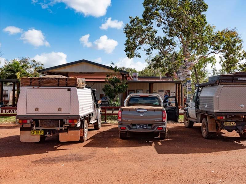 Trucks parked at the front of the Junction Roadhouse at Bramwell Station in Cape York