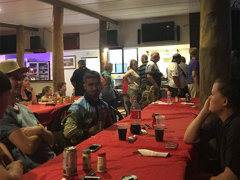 Guest enjoying dinner at the Bramwell Station Tourist Park in Cape York