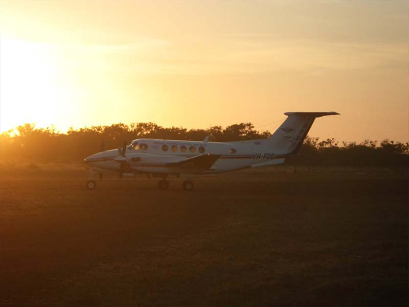 Private charter plane parked on Bramwell Station Tourist Park airstrip in Cape York